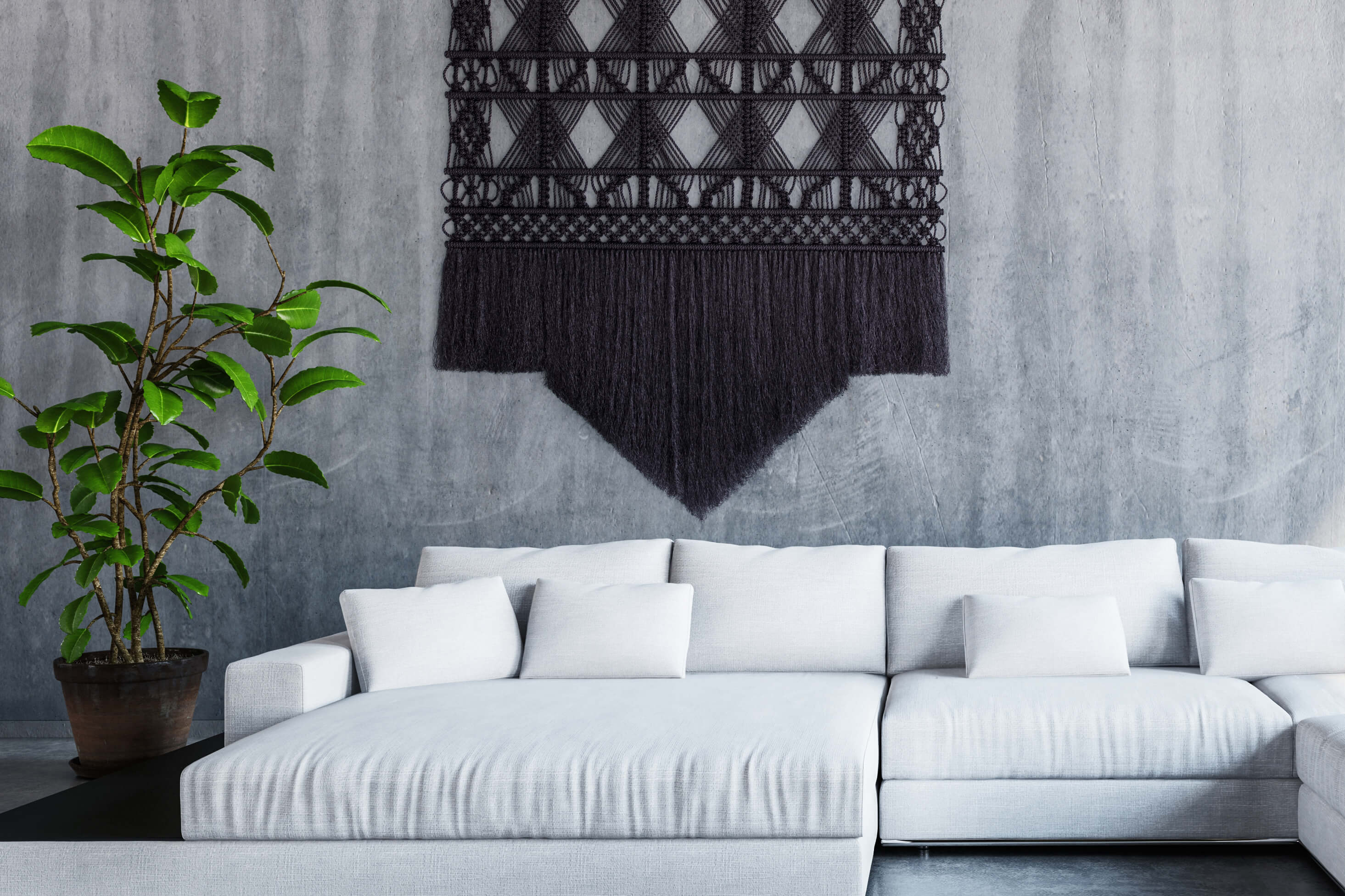 Black at a white couch interior Milla Novo Macrame Wallhanging
